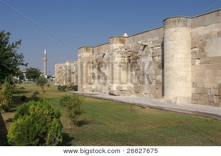 surrounding wall of the Sultanhani caravansary on the Silk Road and minaret, Turkey