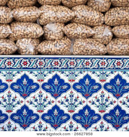 peanuts stacked in plastic bags and decorated ceramics of Iznik