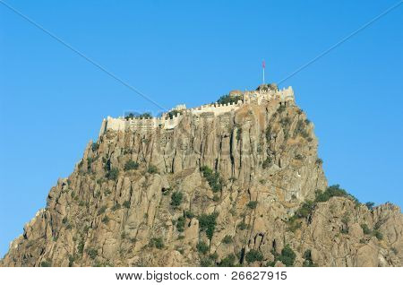 the steep rock topped by kale or Hisar (citadel) as a colossus dominates Afyon, Turkey
