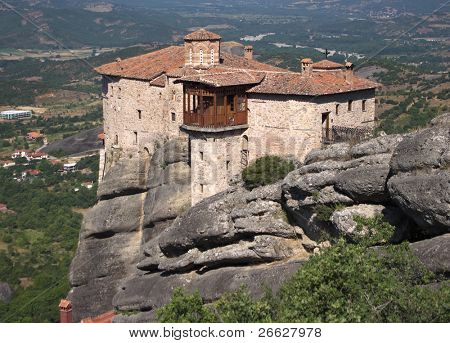 view of Moni Agias Varvaras Roussanou on top rock Meteora, Greece