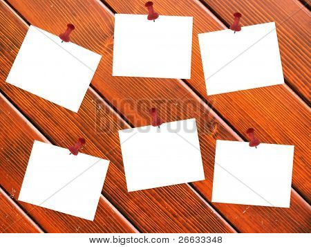 Pined blank papers on wooden planks