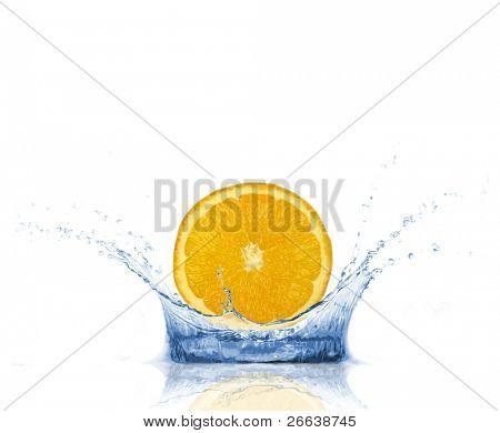 Fresh orange slice dropped into water, isolated on white background