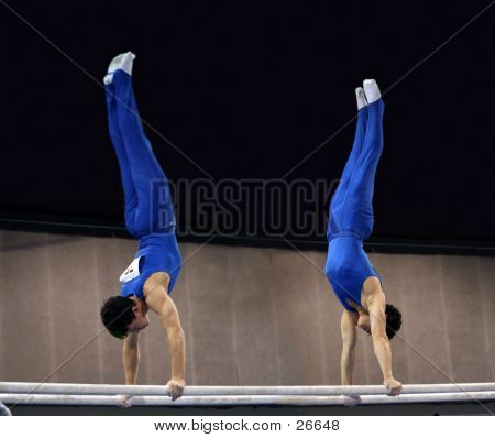 Young Gymnasts Competing On Parallel Bars