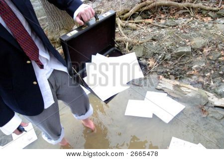 Business Man Scatters Paper In The Woods