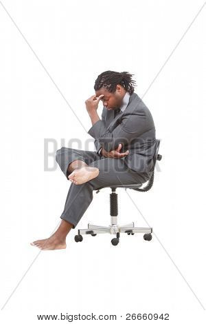 Businessman without shoes sitting on an office chair