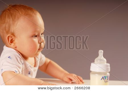 Child With A Feeding Bottle