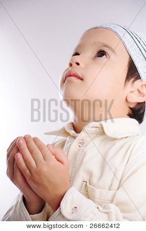Muslim little cute kid with hat, isolated