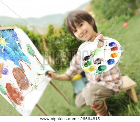 Kid playing and drawing outdoor