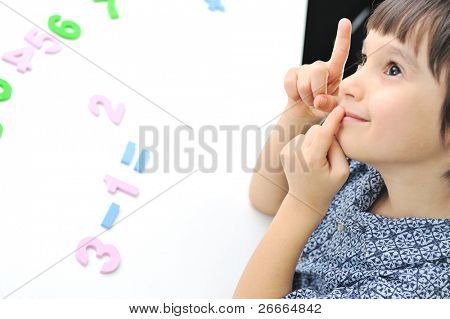 Learning process, cute kid ready for school's activities