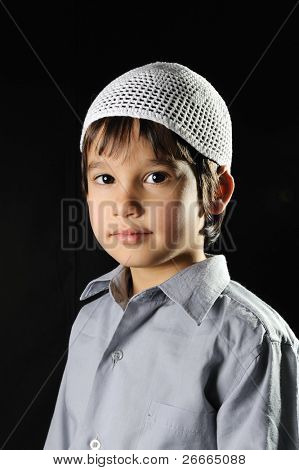 Positive kid with hat on black background