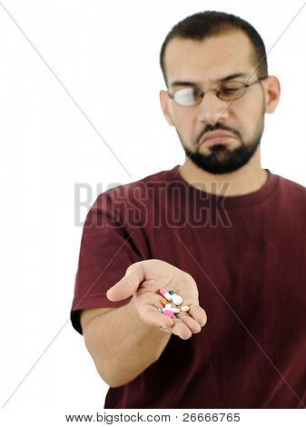 Man disgusts and hates many pills on his palm, isolated