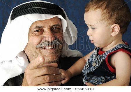 adult man  holding a young baby