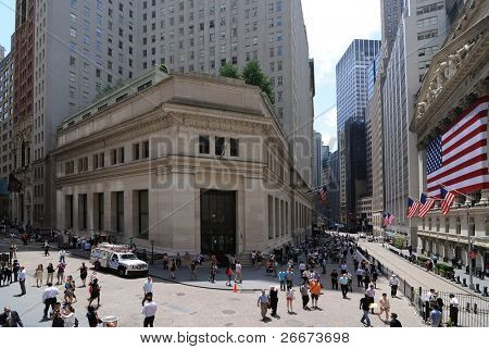 NEW YORK CITY - JUNE 4: The intersection of Broad Street and Wall Street including landmark buildings of the New York Stock Exchange and the House of Morgan June 4, 2010 in New York, New York.