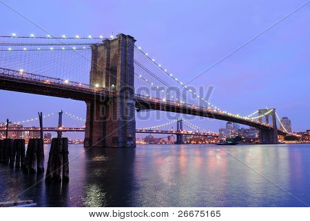 The Brooklyn Bridge shimmering at night.
