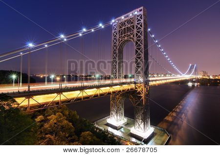 The George Washington Bridge spanning the Hudson River at twilight in New York City.