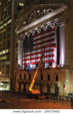 NEW YORK CITY - MAY 26: Crane workers adjust the large New York Stock Exchange flag May 26, 2010 in New York, NY. The NYSE is the largest exchange in the world by Market capitalization.
