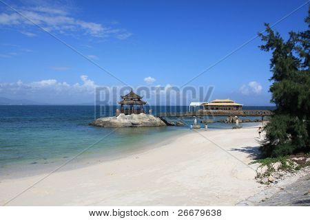wooden pavilion, azure sky, white sand and blue sea --- Sanya, China