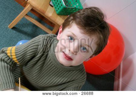 Adorable Four Year Old Boy With Boy At Preschool