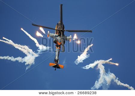 LEEUWARDEN,FRIESLAND,HOLLAND-SEPTEMBER 17:: Apache AH-64D Solo Display Team shoots flares at the Airshow on September 17, 2011 at Leeuwarden Airfield, Friesland, Holland.