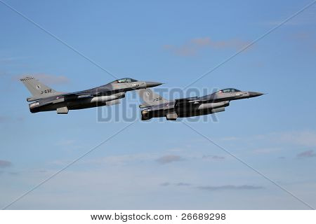 "LEEUWARDEN,FRIESLAND,HOLLAND-SEPTEMBER 17: Two f-16 Fighter Jets in formation at the ""Luchtmachtdagen"" Airshow on september 17, 2011 at Leeuwarden Airfield,Friesland,Holland"