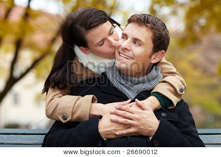 Woman Kissing Man In Park