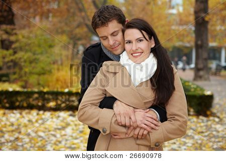 Man Leaning On Woman In Park