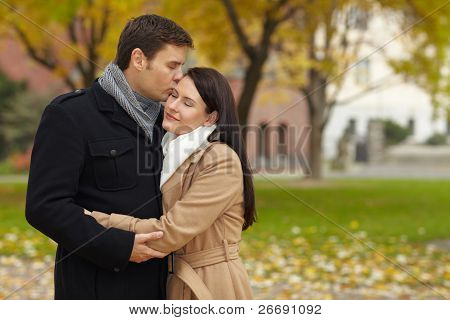 Romantic Kiss In A Park