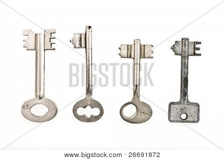 set of old keys isolated on white background