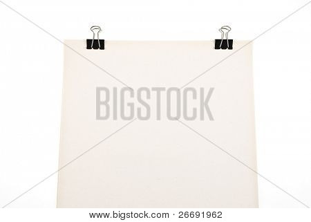 Block of paper attached with paperclips