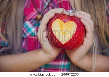 Girl Holding A Ripe Apple