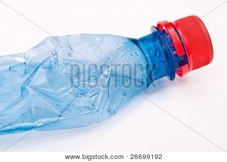 Squashed plastic blue bottle