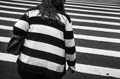 Black And White Manhattan Street Scene. Fat Woman Wearing Black And White Striped Sweater Crosses Th poster