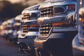 Trucks Dealer Vehicles Stock Row. Selective Focus. Automotive Dealership. poster