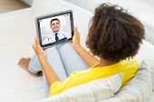 medicine, technology and healthcare concept - african american young woman or patient having video c poster