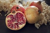 Red Pomegranate And Slice Of Pomegranate On Dark Background Rustic Style. Punica Granatum poster
