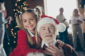 Close-up Portrait Of Joyful Girl Hugging Grandpa In Headwear. Noel Gathering, Full Family Custom. Gr poster