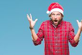 Handsome hispanic man model wearing santa claus christmas over isolated background celebrating crazy poster