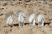 White Sandals. White Sandals On The Beach. poster