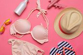 Beachwear And Accessories On A Pink Background poster