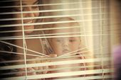 Baby Son And Mother Open Blinds. Woman With Child Smile At Window Shutters. Mothers Day Concept. Hap poster