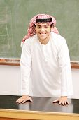 Smiling young success man, arabic traditional clothes, education and fashion concept, indoor, school