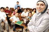 stock photo of muslim kids  - arabic Muslim kids in the school - JPG