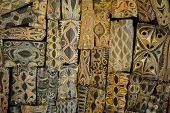 stock photo of cultural artifacts  - Papua New Guinea shields arranged as a ceiling - JPG