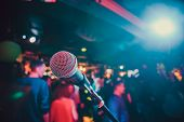 Public Performance On Stage Microphone On Stage Against A Background Of Auditorium. Shallow Depth Of poster