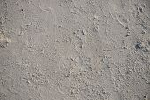 White Sand Beach Texture. Seaside Top View Photo. Dense Sea Sand Natural Texture. Smooth Sand Surfac poster