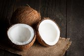 Ripe Half Cut Coconut On A Wooden Background. Coconut Cream And Oil. poster