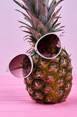 Funny Pineapple Wearing Sunglasses. Hawaiian Ananas In Glasses On Pink Background. Summer Holiday Co poster