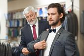 Two Elegant Men Coming To Fashion Boutique On Shopping. Father And Son Looking For Clothes For Speci poster