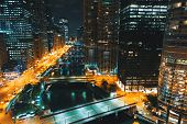 Chicago River With Boats And Traffic At Night In Downtown Chicago poster