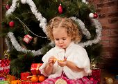 Preaty little girl eating tangerine